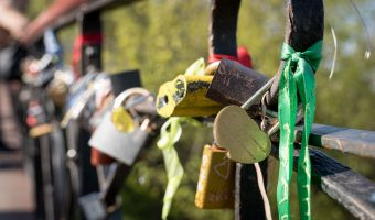 Padlocks attached to the railings on Lovers Bridge in City Garden, Kiev