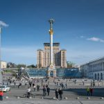 View of Independence Square from Khreshchatyk. Includes the Independence Monument, Petro Tchaikovsky National Music Academy of Ukraine, Hotel Ukraine, and the Globus shopping mall.