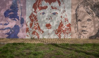 Street art at the playground at Landscape Alley (Peizazhna Alley) in Kiev, Ukraine. These coloured mosaics of children's faces are part of the Kiev Fashion Park Project