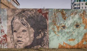 Mosaics of children's faces on a wall. One of many works of street art found at Landscape Alley in Kiev, Ukraine.