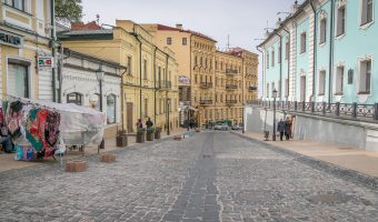 Photograph of Andrew's Descent in Kiev, Ukraine. This photo was taken at the upper end of the street. The wall of St Andrew's Church is on the right.