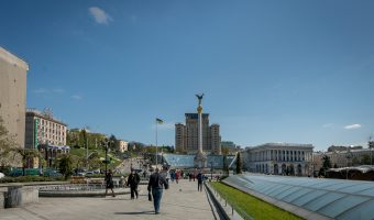 Photo of Independence Square in Kiev, Ukraine. Sights in this photo include the glass roof of the Globus (an underground shopping centre), the Independence Monument, Kiev Conservatory, and Hotel Ukraine.