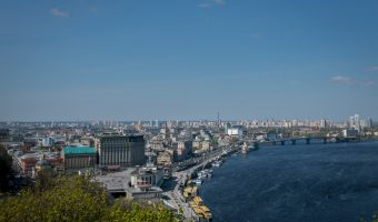 View of the Dnieper River from the viewing area at Khreshchatyk Park. Sights in the photo include Kiev River Port, Postal Square, and the Fairmont Grand Hotel.