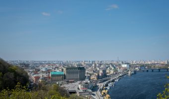 View of the Fairmont Grand Hotel, Kiev River Port, and the Dnieper River from Khreshchatyk Park.