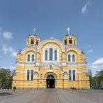 View of main entrance to St Volodymyr's Cathedral, a striking building with yellow walls. Situated in Kiev, Ukraine.