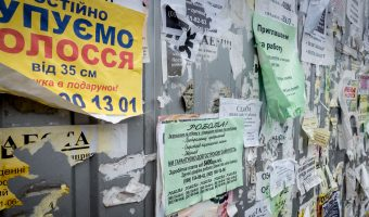 Paper advertisements on a wall at Vydubychi Bus Station in Kiev, Ukraine. These sticker/note adverts are extremely common in the city.