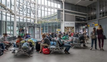 Waiting area at Vydubychi Bus Station in Kiev, Ukraine. Photo of passengers waiting for buses.