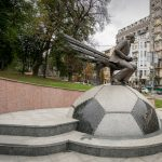 Statue of former coach Valeriy Lobanovskyi at the Dynamo Stadium in Kiev, Ukraine. The coach sits on a trainer's bench, mounted on a large football. It was erected in 2003, on the first anniversary of the coach's death.