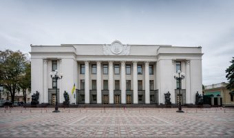 Front view of the Verkhovna Rada from Constitution Square. The cost of arms of Ukraine can be seen above the main entrance.