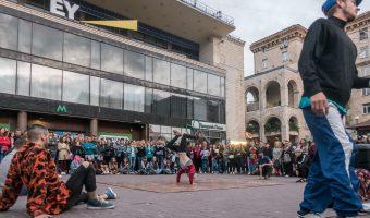 Breakdancer performing a handstand near entrance to Khreshchatyk Metro Station in Kiev, Ukraine