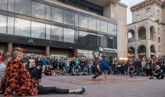 B-boy breakdancer performing a swipe move near Khreshchatyk Metro Station in Kiev, Ukraine