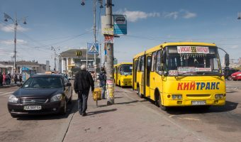 Buses and a taxi outside Kiev Train Station (Central Station terminal). The McDonald's restaurant can be seen in the distance.