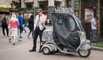 Man with a zebra-styled mobility scooter on Khreshchatyk in Kiev, Ukraine.
