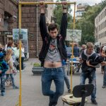 Beat the bar street game. Hold onto horizontal bar for 2 minutes and win a prize.