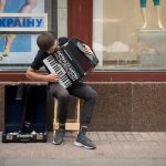 Photo of a busker playing a Weltmeister accordion in Kiev, Ukraine