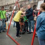 Street game. Climb a ladder to win a prize.