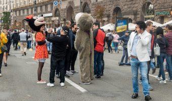 Arab men on Khreshchatyk in Kiev having their photos taken with costume characters