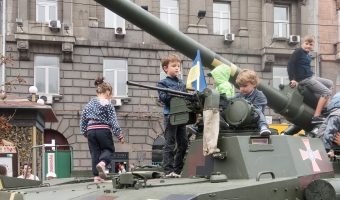 Children playing on the turret of a tank in Kiev, Ukraine