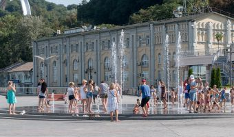 Children playing in the fountain at Postal Square in the Podil area of Kiev, Ukraine