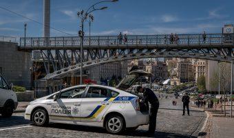 Photo of police car on Heroyiv Nebesnoyi Sotni Alley in Kiev, Ukraine.