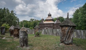 Wooden beehives and 18th century church from Rivne region of Ukraine. Located at Pyrohiv (Pirogov) Museum of Folk Architecture and Everyday Life in Kiev, Ukraine.