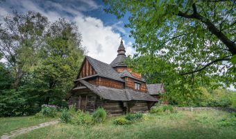 Early 19th century wooden church from Ternopil region of Ukraine. Located at Pyrohiv (Pirogov) Museum of Folk Architecture and Everyday Life in Kiev, Ukraine.