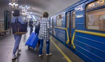 Photograph of passengers boarding a train at Kharkivska Metro Station in Kiev, Ukraine.