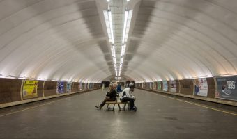 Photograph of passengers sitting on benches at Osokorky Metro Station in Kiev, Ukraine.