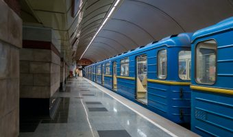 Photograph of train waiting at platform of Syrets Metro Station in Kiev, Ukraine.