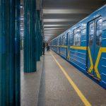 Passengers boarding at train at Nyvky Metro Station in Kiev.
