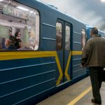 Photo of passengers boarding a train at Arsenalna Metro Station in Kiev, Ukraine.