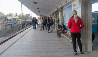 Passengers on the platform at Livoberezhna Metro Station.