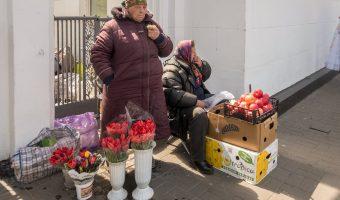 Babushkas (old women) selling fruit and flowers. Photograph taken near the entrance to Universytet Metro Station in Kiev, Ukraine.