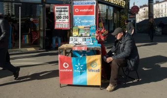 Street vendor selling SIM cards at the entrance to Shuliavska Metro Station in Kiev, Ukraine.