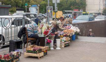 Babushkas selling flowers near the entrance to Palats Ukrayina Metro Station.